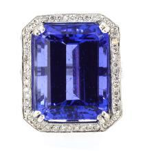17.21ct. Center Emerald Cut Tanzanite Ring 18K