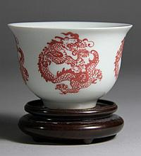 A RED GLAZED PORCELAIN CUP