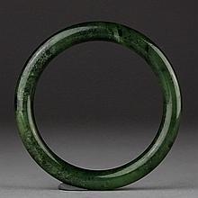 A SPINACH-GREEN JADE BANGLE