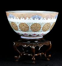A QIANLONG MARKED FAMILLE ROSE EGGSHELL 'FU SHAO' BOWL WITH WOOD STAND