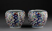 A PAIR OF MING WANLI WUCAI BLUE AND WHITE 'DRAGON AND PHOENIX' JARS