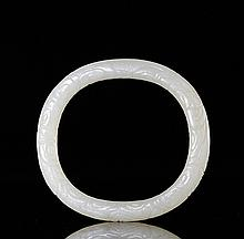 A QING QIANLONG WHITE JADE CARVED 'DRAGON AND THUNDER' PATTERN BANGLE