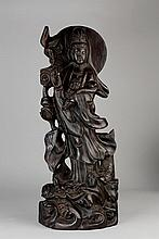 A CARVED ZITAN/ROSEWOOD FIGURE OF GUANYIN