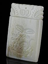 A PALE GREENISH-WHITE AND RUSSET JADE RECTANGULAR PLAQUE