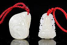 TWO SMALL PALE GREENISH-WHITE JADE PENDANTS