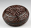 A SMALL CARVED CINNABAR LACQUER CIRCULAR BOX AND COVER