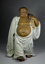 A RARE SHI WAN LAUGHING BUDDHA PORCELAIN FIGURE