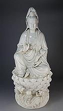 A LARGE DEHUA FIGURE OF GUANYIN