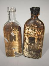 Two Warner's Safe Remedies Bottles.