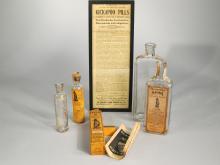 Four Kickapoo Medicine Bottles.