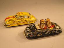 Two Marx Wind Up Cars.