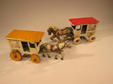 Two Marx Toyland's Farm Products Wind Up Tin Horse Drawn Wagons.
