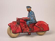 Auburn Rubber Toy Motorcycle Cop. From the collection of Bill Ferretti.