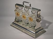 English Plated Silver Three Bottle Tantalus.