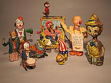 Eight Vintage Wind Up Toys.