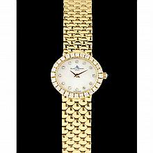 Lady's 18KT and Diamond Watch, Baume and Mercier