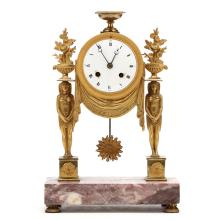 A French Egyptian Revival Gilt Bronze Mantel Clock