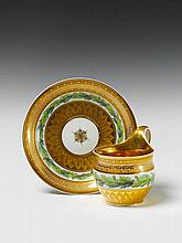 A Berlin KPM porcelain cup with oak leaf decor.