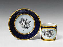 A Berlin KPM neoclassical porcelain cup and saucer with floral decor.