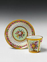 A Berlin KPM porcelain cup and saucer with a floral still life.