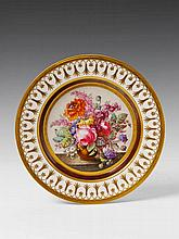 A signed Berlin KPM porcelain plate with floral still life decor.