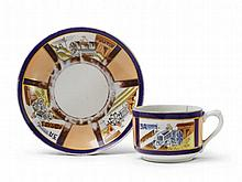 A porcelain cup and saucer with gilt and enamel tractor decor, inscribed