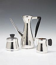 A Cologne silver interior gilt mocca service. Comprising coffee pot, milk jug and sugar box. The handles and finial of ebony. Marks of Wilhelm Nagel, 1950s.