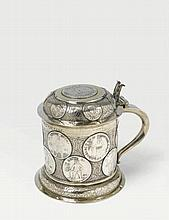 A rare Sorau/Lusatia silver partially gilt tankard. Set with coins dated between 1535 and 1714. Engraved with the monogram 'M.E.V.W.G.V.H'. Unidentified maker's mark 'IGN', ca. 1720 - 40.