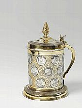 A large German silver partially gilt coin-set tankard. Unmarked, ca. 1700.