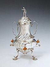 An Augsburg silver coffee urn with three wooden handled taps. Marks of Johann Georg Kloss(e), 1747 - 49.