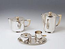 A Weimar silver art déco service. Comprising coffee pot, teapot, sugar box, milk jug and a small tray. The handles and finials of ivory. Marks of Theodor Müller, ca. 1920.