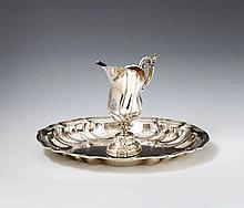 An Augsburg silver washbasin and pitcher set. The pitcher with an engraved coat of arms. Marks of Adolf Carl Holm, 1759 - 61.