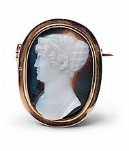 An 8/9k red gold neoclassical cameo brooch.
