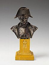 A patinated and gilt bronze bust of Napoleon Bonaparte.