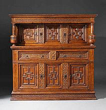 An English Charles I period iron mounted carved oak cupboard.