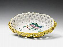 A Schleswig-Holstein faience openwork fruit basket with mixed floral decor.