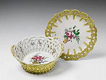 A Strasbourg faience basket and platter with mixed floral decor.