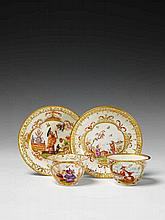 A Meissen porcelain tea bowl and saucer with Chinese figures making tea.