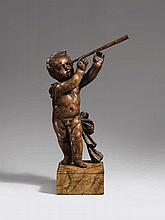 A late 17th century Flemish carved wooden figure of a putto with a telescope.