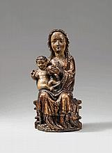 A probably Central Rhenish carved wooden figure of the Virgin Enthroned, 2nd half 15th century.