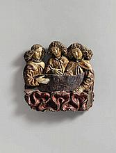 A probably Central Rhenish carved wooden relief of three angels among clouds, second half 15th century.