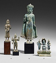 A small bronze figure group of Buddha Mucalinda. Cambodia. 12th/13th century