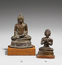 A small Thai bronze figure of a monk in prayer. 17th/18th century