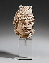 A Hadda type terracotta male head. Ca. 3rd century