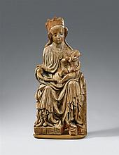 An East German limewood figure of the Virgin Enthroned, circa 1370/1380