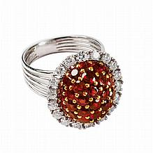 An 18k white gold, diamond and ruby cluster ring