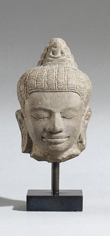 A Bayon-style stone head of Lokeshvara. Cambodia. 13th century