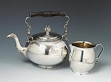 A Goldingen silver teapot and milk jug with remains of interior gilding. Monogrammed