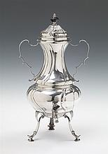 A Cologne silver coffee urn. The handle and finial of ebony. Marks of Hermann Joseph von der Rennen, 1774 - 79.