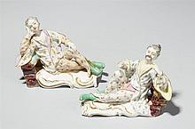 A rare pair of Frankenthal porcelain recumbent Chinese figures